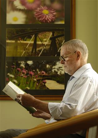 man reading brochure